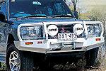 Передний бампер Mitsubishi Pajero 1991-2000 с дугой Deluxe 91-99 WITH FLARES под лебёдку (ARB, 3434030)