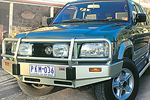 Передний бампер Isuzu Trooper с дугой Deluxe 01 WIDE BODY W/SRS под лебёдку (ARB, 3444070)