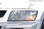 Накладки фар Mitsubishi Pajero V series Type B 99- передние (Jaos, 852312)